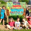Daisy Girl Scout Troop builds Community Garden sign