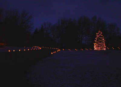 Luminaria along a curving road.