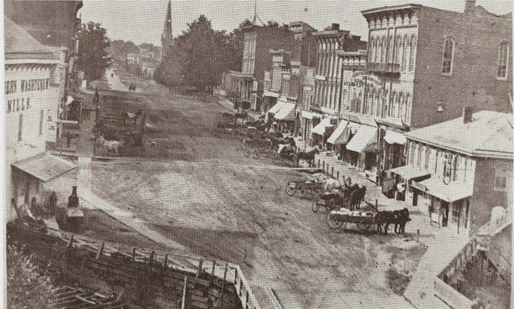 Figure 8 – View of 1870 Streetscape Improvements – Wooden Crosswalks Sidewalks, and Hitching Posts.