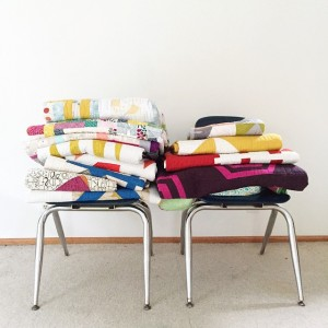Stacks of quilts represent some of the work that Rossie Hutchinson has created.