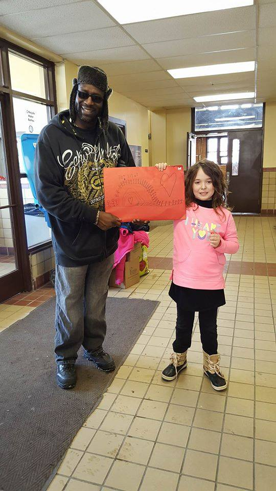 On the envelope of the big card Annabelle made for the City of Flint on behalf of Manchester, she drew people holding hands around the world to let Flint know that we ALL love them. Photo courtesy of the Celkis family.