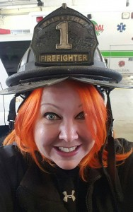 Annabelle's mother, Stephanie, trying on a real firefighter helmet at the Flint Fire House they first communicated with. Photo courtesy of the Celkis family.