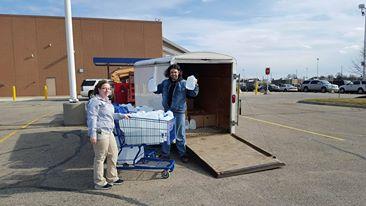 Gary H. and Cheyenne Fox Service team leader of Meijer Cascades Store #50 helped load up the 500 gallons of water. Photo courtesy of the Celkis family.