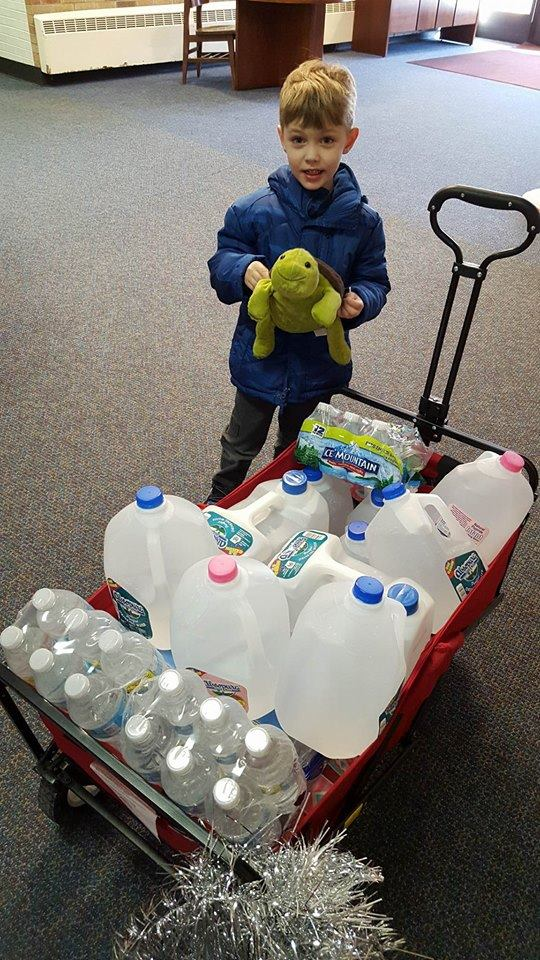 "Paul's classmates from MECC in the VanBogelen Preschool Class donated this much water for him so he could help out his sister. They also let ""turtle"", the class mascot, go with Paul on this adventure so he could come back to school to tell about it. (Turtle appears in many of these pictures.) Photo courtesy of the Celkis family."