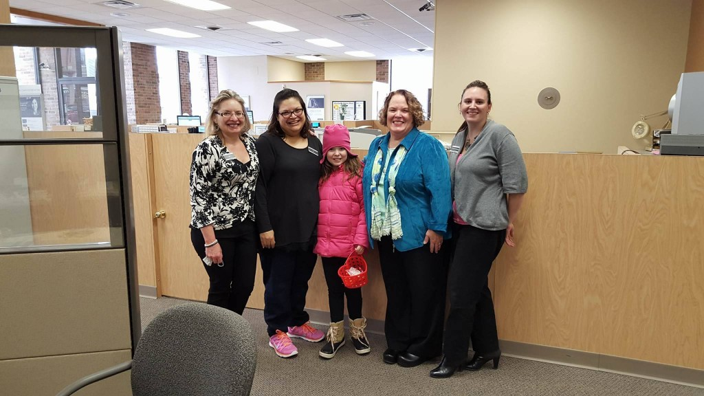The ladies at Comerica Bank always have treats for Annabelle when she shows up. Photo courtesy of the Celkis family.