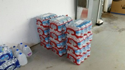 """480 bottles of water were donated by Lerner Publishing house. The ones who published the book, """" Love, Ruby Valentine."""" Not the first time they have donated and gifted Belle and her mission. They write every year telling her how proud they are. This year I even got to talk to the Author. She was in tears with joy knowing that she could inspire Belle. She sent 100's of book marks to Belle to give to her friends at school. Wish she could be a guest Author sometime. Photo courtesy of the Celkis family."""