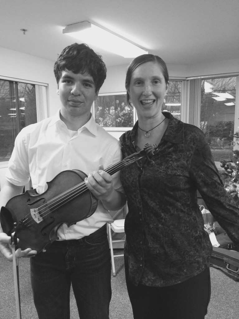 Alden with his violin instructor Carolyn Lukancic in February. Photo courtesy of Aileen Rohwer.
