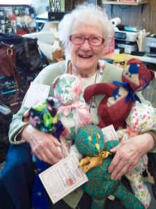 Shirley holding a few of her bears. Photo courtesy of Christine Baisden.