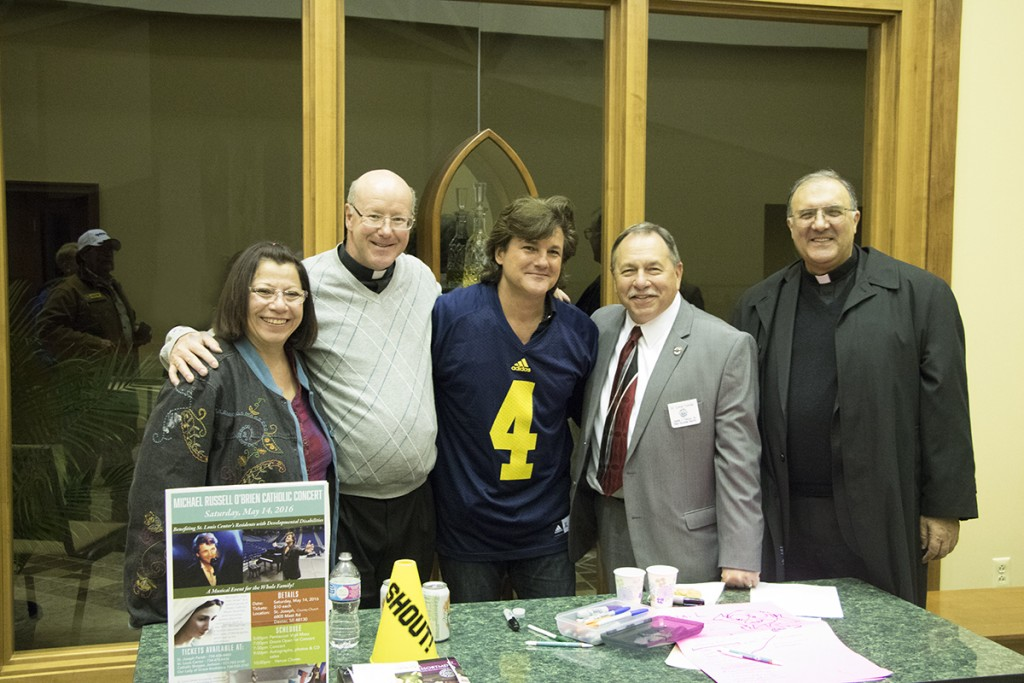 Michael (center) poses with Deb, Fr. Brendan Walsh, Joe Yekulis, & Fr. Enzo Addari of St. Louis Center. Photo courtesy of St. Louis Center.