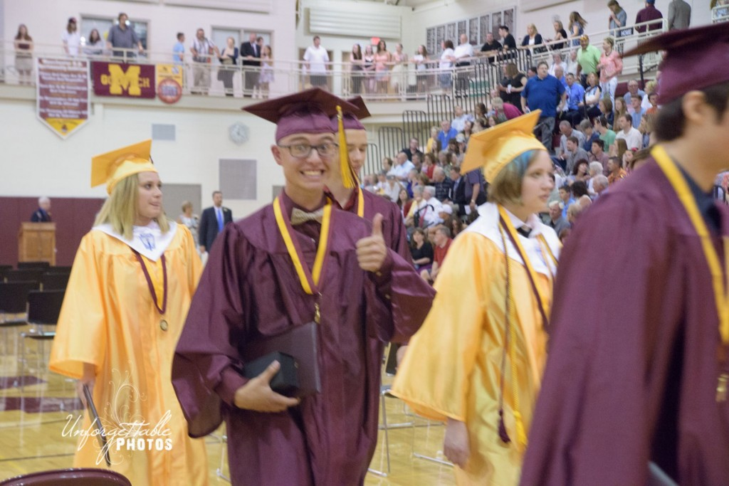 "John Beuerle gives a ""thumbs up"" during the recessional."