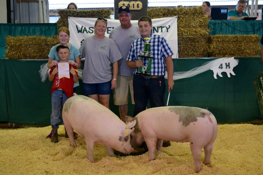 Eli Schmitt, with the Reserve Champion Pair Market Hogs. Photo courtesy of Kellie LeBlanc.
