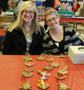 Two 2015-2016 school year German Club students selling handmade ornaments at Christmas in the Village last year.