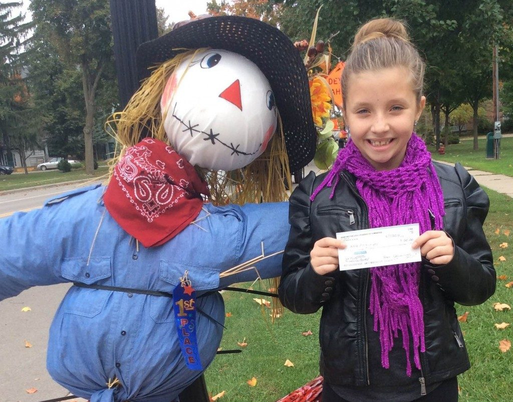"Last year's winner Anna Amburgey of the Builders Club won $50 with her ""girl scarecrow"" which was on display at the corner of Macomb and West Main last October."