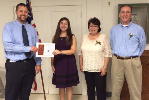Caitlyn Baskin receives recognition as student of the month from Kevin Mowrer at the most recent Civic Club meeting. She is joined by her parents Nora and Baskins. Photo courtesy of the Manchester High School.