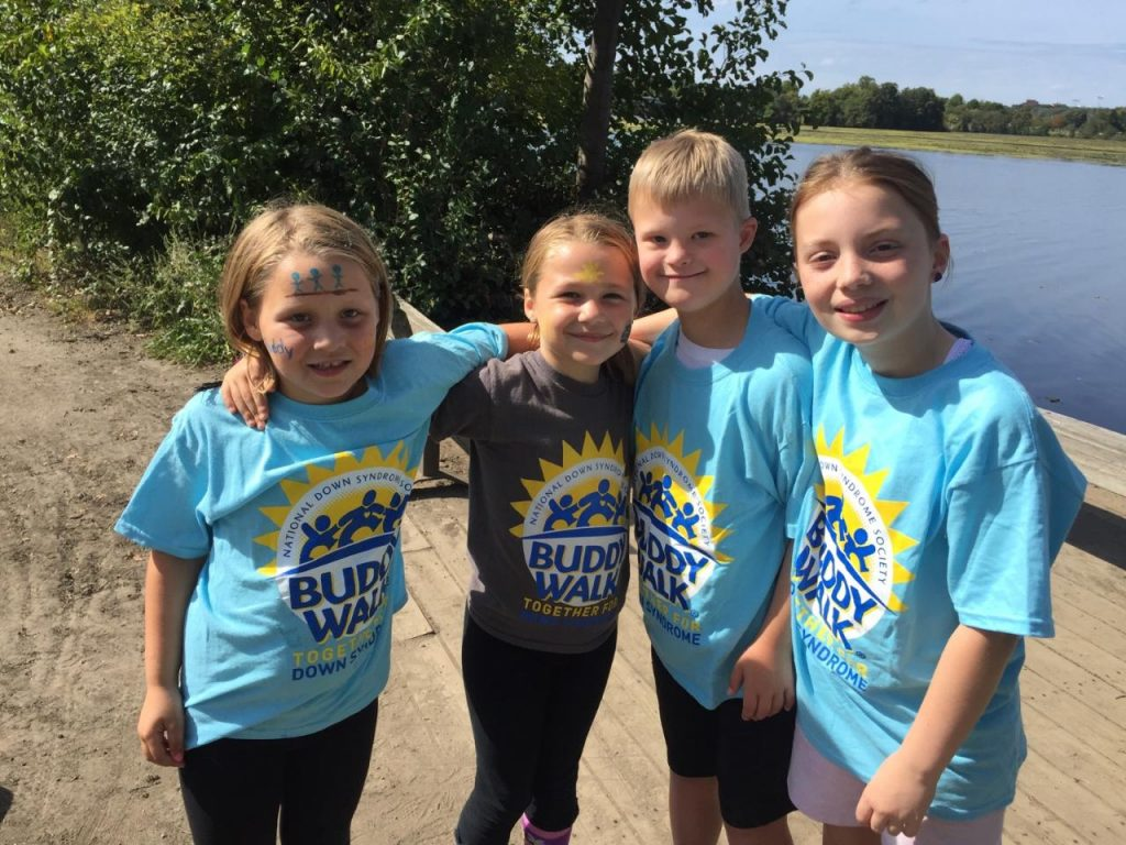 Kayley and Ashley Bobo take a quick break with Wil Taylor and Lila Harvey at the 12th annual Down Syndrome Support Team Buddy Walk. The walk in Washtenaw County is one of 250 Buddy Walks around the country.