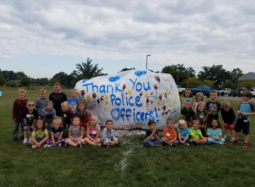 """This year I plan on having my kindergarten class really focus on giving back and serving our first responders. Last week we did something special for our Police Officers and painted the rock at the High School for them. In October, I plan on doing the same thing for our Fire Fighters, and we will be adopting a veteran this Christmas."" Submitted by Melissa Yekulis."