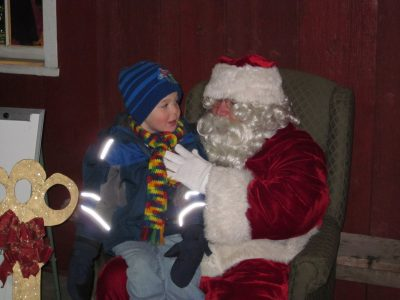 Santa will once again greet children on the Mill Porch after the parade. Photo courtesy of the Chamber of Commerce.