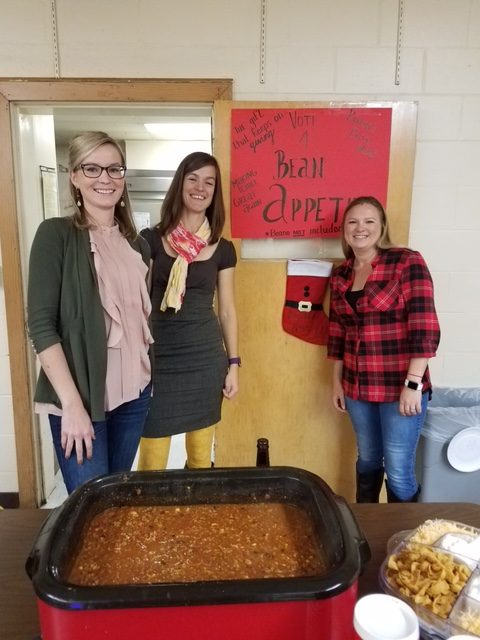 Co-op preschool teachers Anneke Marshall (center) and Brandi Bennett (right) are joined by Anneke's sister, Irene Schafer (left), at the cook-off.