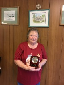Carol Britten proudly displays her 2017 Hall of Fame award from the Michigan Association of Fairs and Exhibitions.
