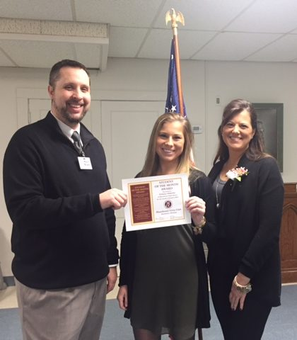 Delanie Osbourne, shown with her mother Carrie Osborne, receiving January student of the month award from Manchester High School principal Kevin Mowrer. Photo courtesy of Manchester High School.