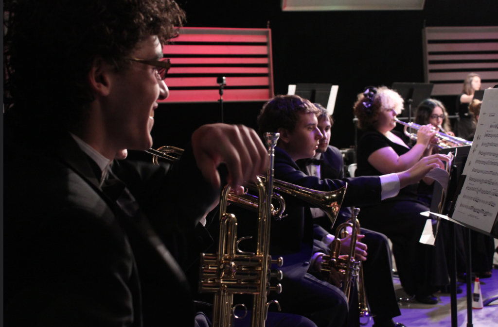 Rachel Allen shown here with trumpet section of MHS band last fall. Photo courtesy of WKAR.